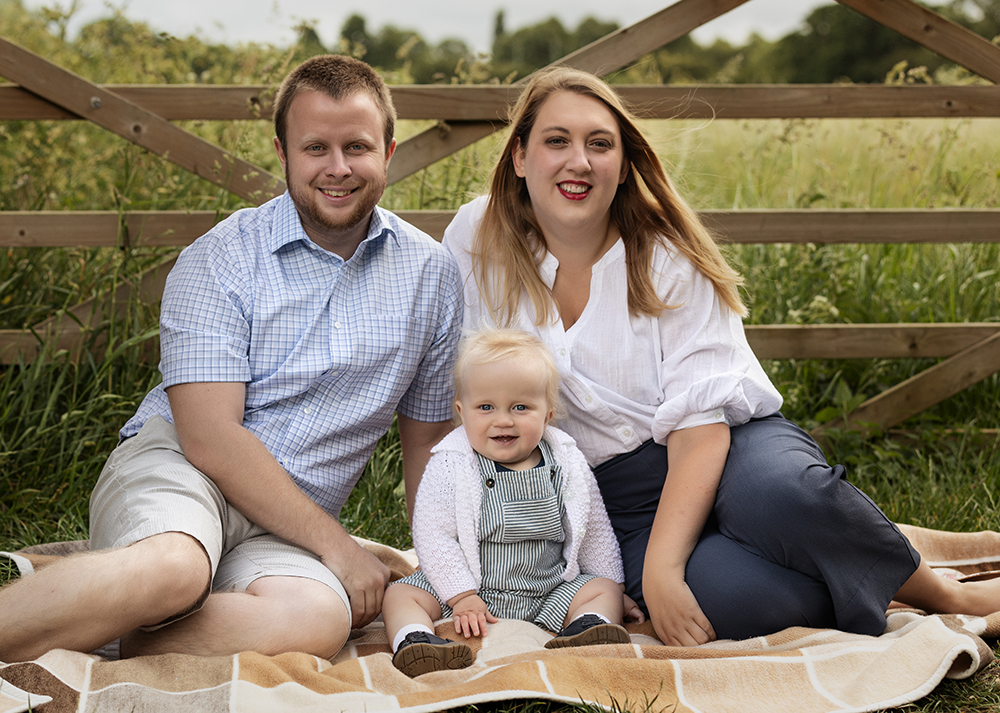 Outdoor photograph of family with little boy in summertime by Family Photographer Milton Keynes