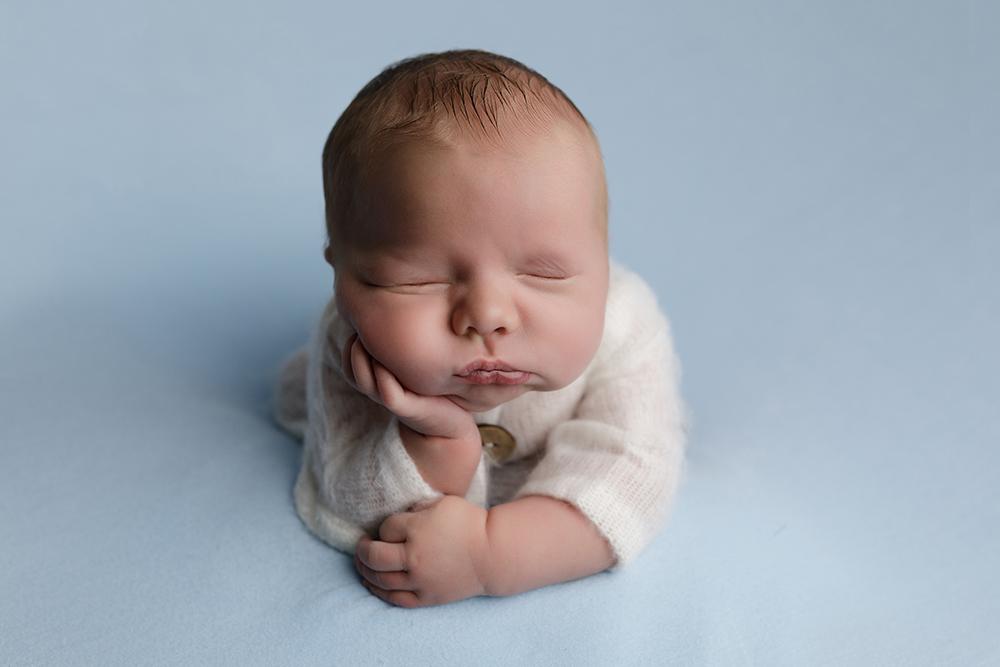 baby boy froggy pose on blue blanket by Newborn Photographer in Milton Keynes and Northampton
