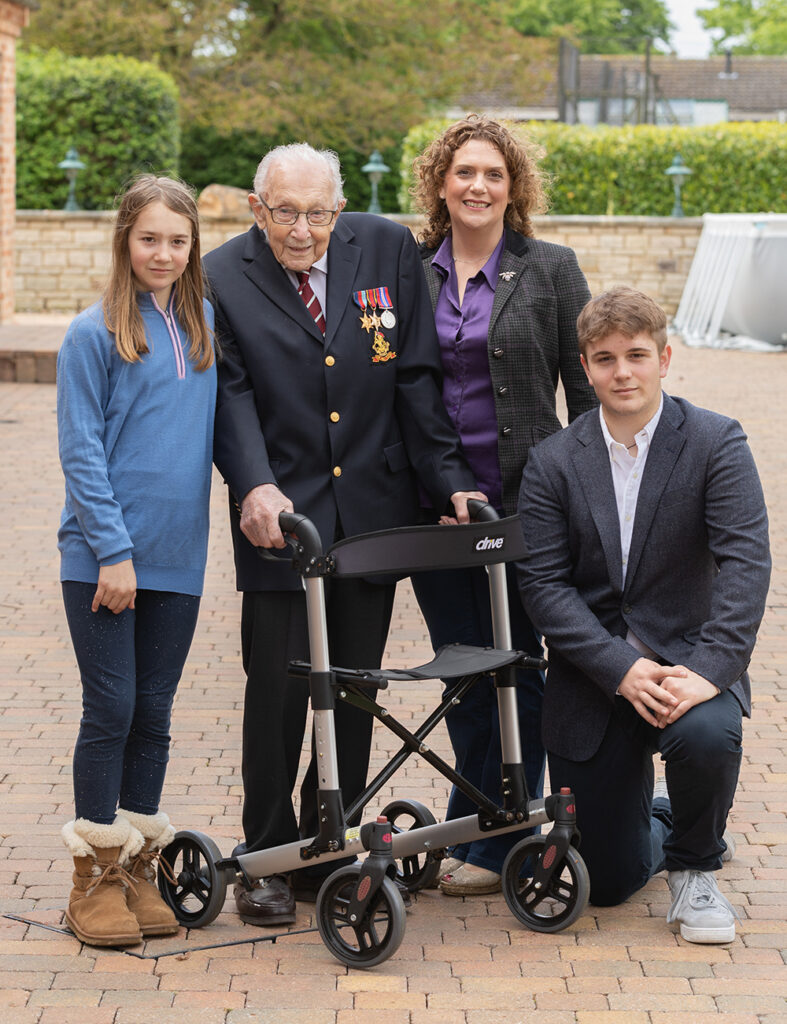Captain tom and his family in his garden by family photographer milton keynes