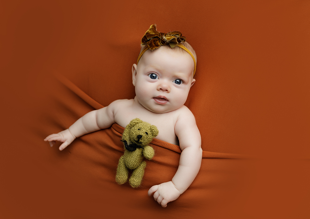 Baby girl with her teddy at Older newborn photoshoot Milton Keynes